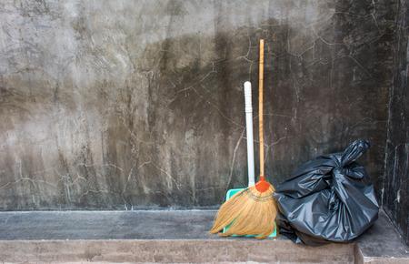 black plastic garbage bag: Broom For Floor Dust Cleaning and Black Plastic Garbage Bag Stock Photo