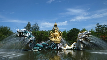 bodhisattva: this is sculpture of bodhisattva located in the middle of the water in thailand. Stock Photo