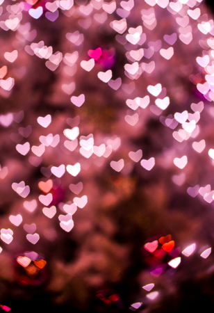 Valentines day background with hearts.Bokeh hearts