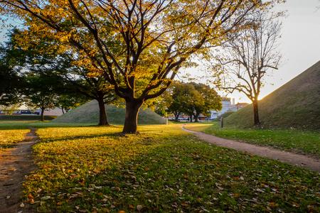 sunset at tumuli park historic park , Gyeongju South Korea Фото со стока