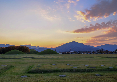Tumuli of silla royal king mound in gyeongju, south korea. Taken during sunset hours