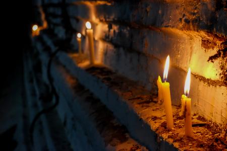 Candle lights praying around the buddha temple
