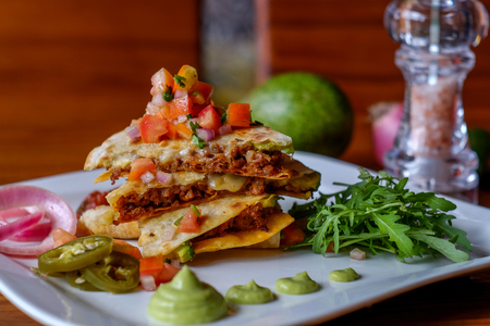 Mexican quesadillas  with cheese, vegetables and salsa