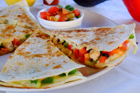 Mexican quesadillas chicken with cheese, vegetables and salsa