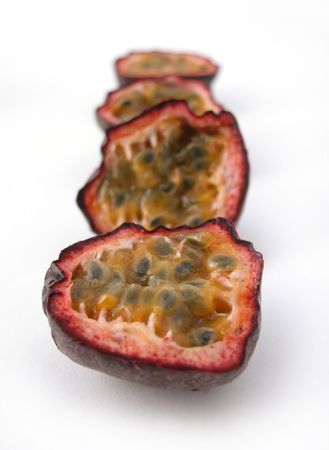Passion fruit cut in half on a white back ground Stock Photo