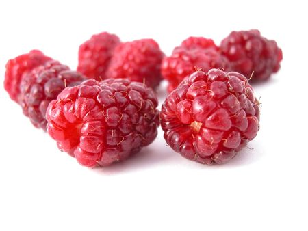 delicious raspberries on a white back ground
