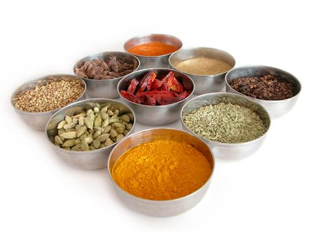 silver bowls of spices photo
