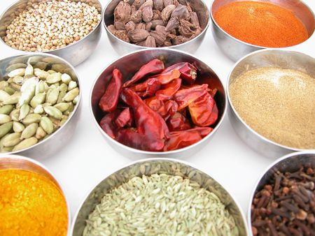 silver bowls of spices
