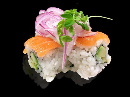 isolated pieces of salmon sushi on a plain background Stock Photo
