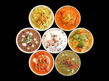 beef curry: assortment of indian dishes on a black background Stock Photo