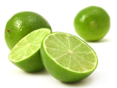 fresh cut green lime on a plain background Stock Photo