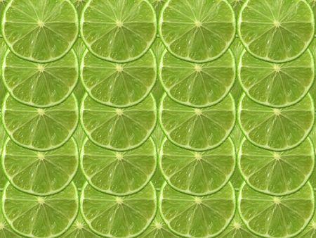 fresh cut green lime on a plain background photo