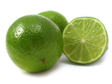 fresh cut green lime on a plain background photo