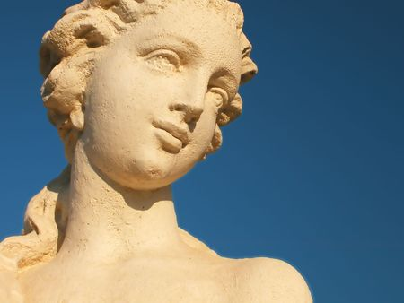 female statue with a blue sky background
