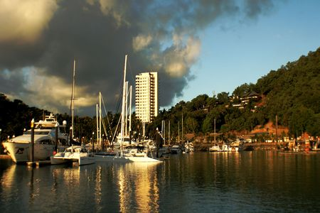 boats on Hamilton Island with one building in the background Stock Photo