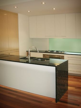 kitchen counter top: New trendy kitchen in luxury home
