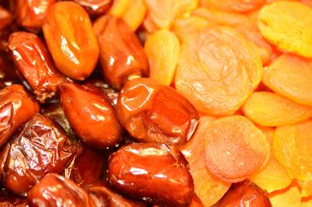 eastward: Dried fruits: delicious dates and dried apricots closeup Stock Photo
