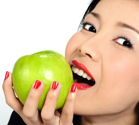 Beautiful young asian girl eating apple Stock Photo - 6332640