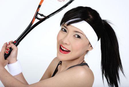 squash: Young asian woman playing squash Stock Photo