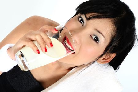 drinking milk: Young asian woman drinking milk  after practicing sport
