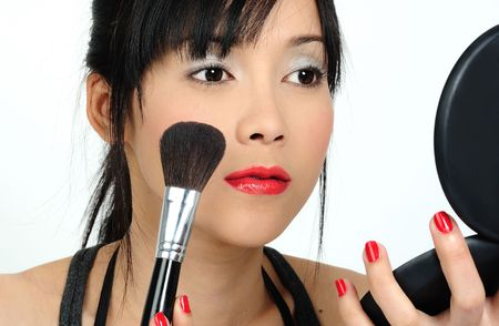 Young asian woman doing make-up photo