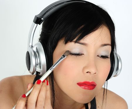 Young asian woman doing make-up Stock Photo - 6332646