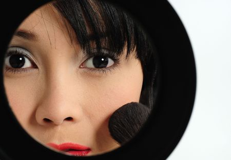 Young asian woman doing make-up Stock Photo - 6332674