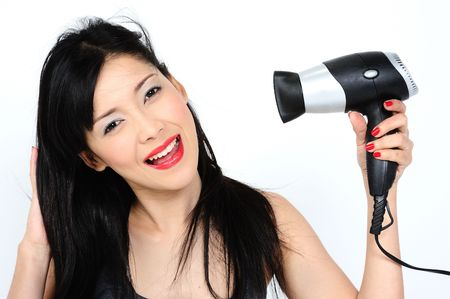 Young asian woman angry with hair dryer photo