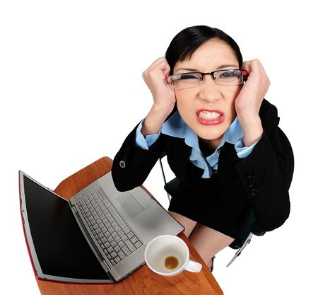 unexpected: Young asian woman angry with her computer