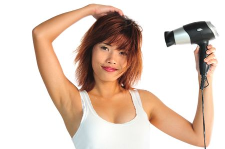 Very seductive young asian woman with hair dryer photo