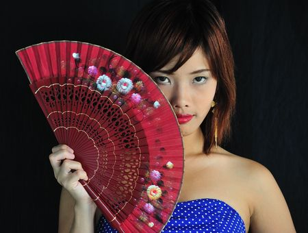 Very seductive young asian woman with a red fan  photo