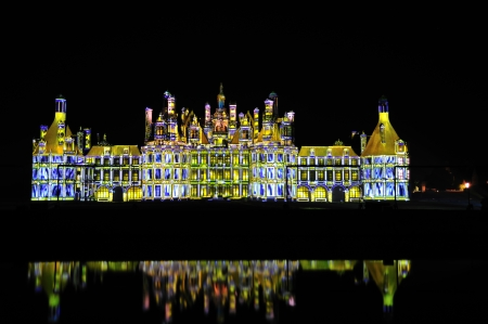 chambord: Chambord, France - September 20th, 2008 - Large panoramic view of Chambord castle during the night light show