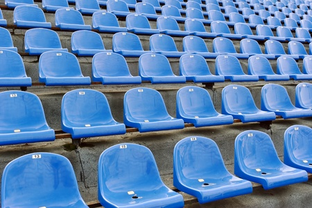 numbering: Blue plastic seats at the stadium with numbering
