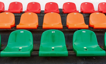 numbering: Multicolored plastic seats at the stadium with numbering