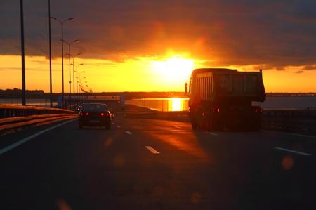 car at sunset highway photo