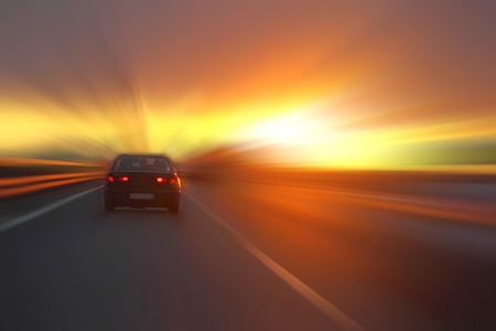 car at sunset on the highway Stock Photo - 10856110