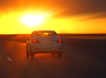 car at sunset on the highway photo
