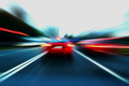 speed motion red car on street Stock Photo - 15922863
