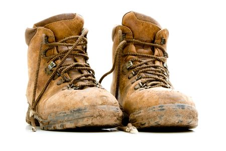 walking boots: Pair of old worn walking boots Stock Photo