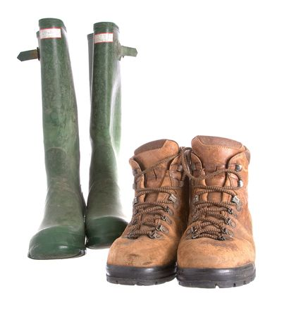 wellingtons: Old walking boots and green Wellingtons Stock Photo
