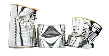 Three damaged tin cans isolated against a white background.  DOF is from front to back (everything in focus).