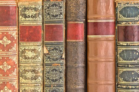 with spines: Old leather bound book spines  Stock Photo