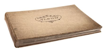 Old photography album isolated against a white background photo