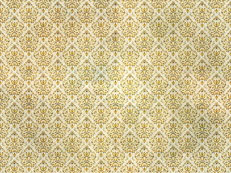 Old and distressed gold damask wallpaper photo