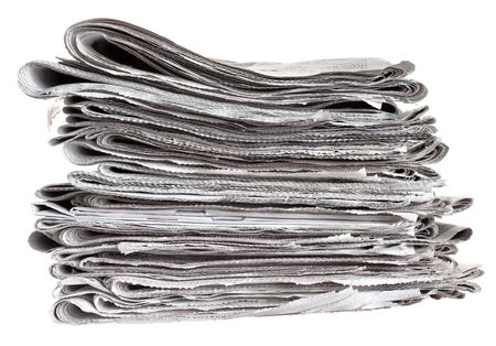Pile of folded newspapers isolated against a white background photo
