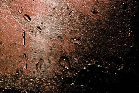 drops and their reflections on transparent plastic creating a grunge background.