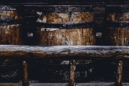 old wooden barrels for storing alcoholic beverages.