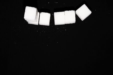 several sugar cubes on a black background. Zdjęcie Seryjne