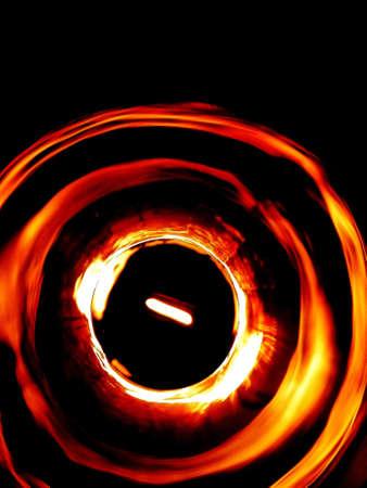 Fire circle twirl motion on black background