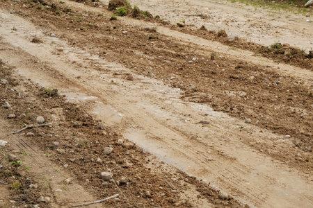 Dirty ground after rain. rural dirt road. Stock fotó
